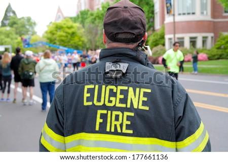 EUGENE, OR - April 28: Eugene Fire marshall looks on as runner start the Eugene Marathon on April 28, 2013 in Eugene, OR. The Eugene Marathon is a premier marathon in the U.S.
