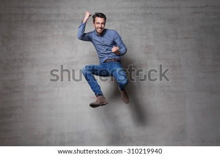 euphoric business man jump wall #310219940
