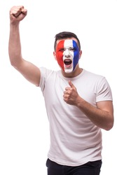 Euphoric scream of France football fan in win game or score of France national  team.  Big smile, scream, Hands over head look at camera  on white background. European  football fans concept.