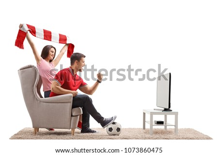 Euphoric soccer fans watching football on television isolated on white background