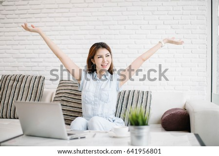 Euphoric winner watching a laptop on a desk winning at home Images