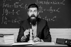 Eureka. Bearded man do science research. University teacher in research laboratory. Using microscope for important research purpose.