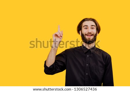 Eureka, Guy got excellent idea sharing with team. Enthusiastic excited good-looking male  raising index finger in eureka gesture holding breath, isolated, copy space