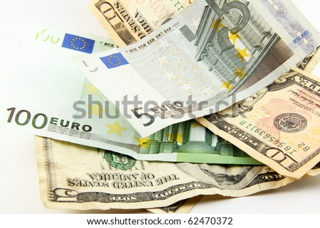 Euro and dollar bills isolated on white