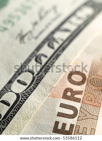Euro and dollar money bills ,closeup image with shallow DOF, useful for various financial,economic or exchange themes