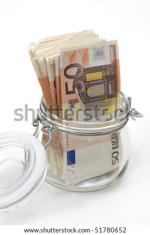Euro bank notes in a glass jar on white background