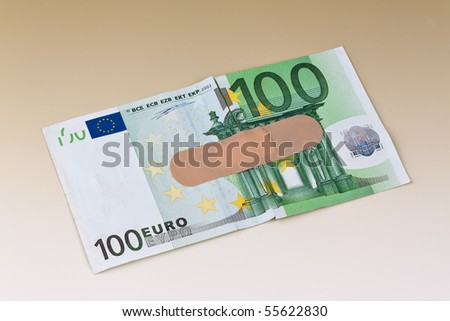 Euro bank notes with a band-aid