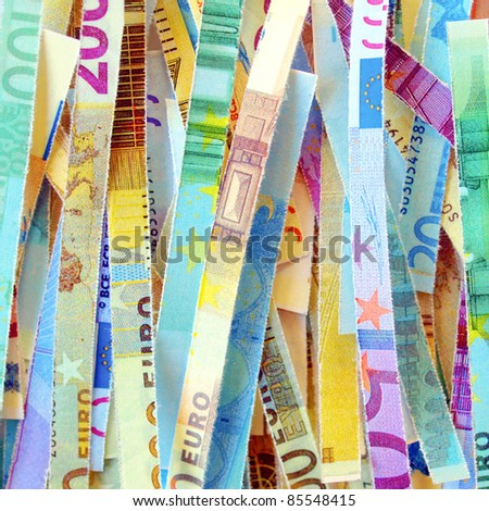 Euro banknote (currency of the European Union) in a paper shredder