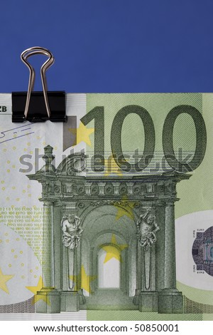 Euro banknote with binder clip, close-up