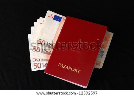 euro banknotes and a passport on black background
