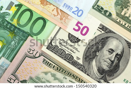 euro banknotes and dollars of...
