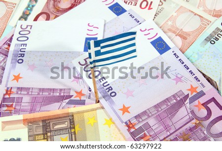 Euro banknotes and greek flag