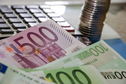 euro banknotes, coins and calculator, close-up