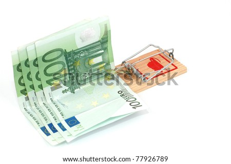 Euro banknotes in a mousetrap, business risk concept, money concept