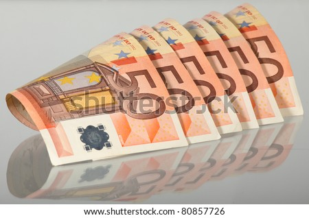 Euro banknotes isolated on grey with reflection