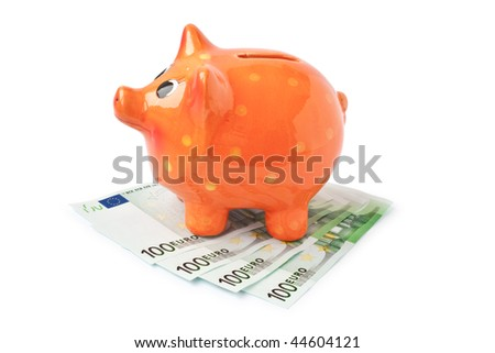 euro banknotes over money box isolated on white