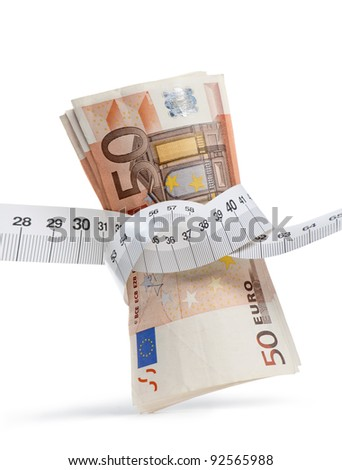 euro banknotes with measure tape on white background, vertical image