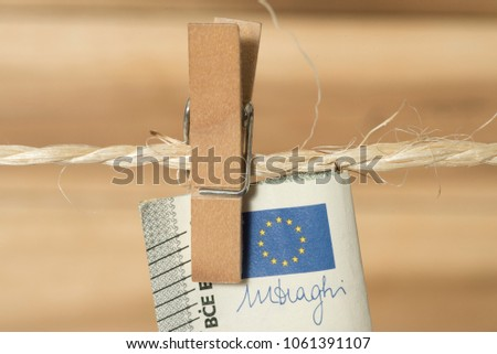 Euro bills, clothesline and clothespin #1061391107