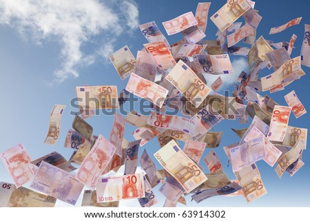 euro bills flying in the sky