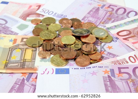 Euro bills with coins