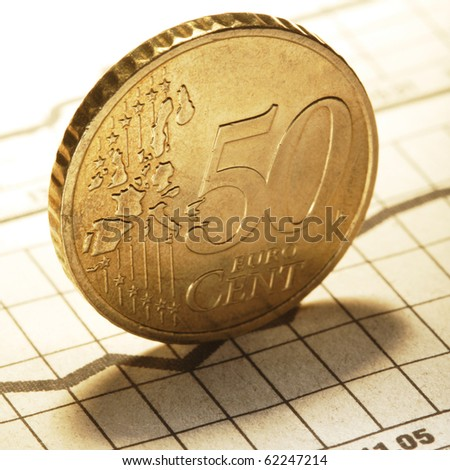 euro cent on newspaper chart - stock photo