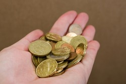 Euro cents in a woman's hand. Close-up. Coins in hand. Financial concept.