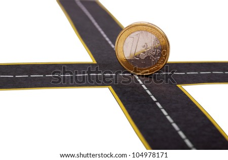 euro coin at the crossroads