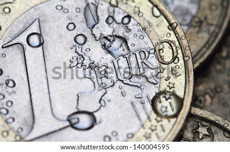 euro coin detail with water drops