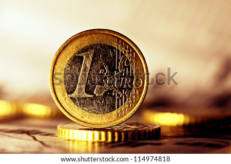 Euro coin on stock chart.