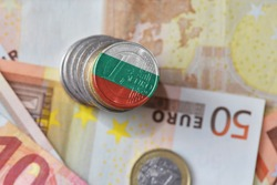 euro coin with national flag of bulgaria on the euro money banknotes background. finance concept