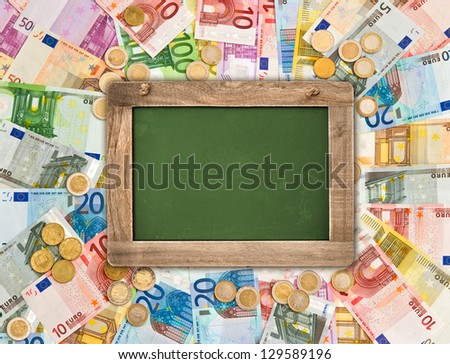 euro coins and banknotes background with green chalkboard for your text. money concept