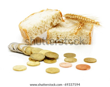 Euro coins and brad slices with grain ears, isolated on white