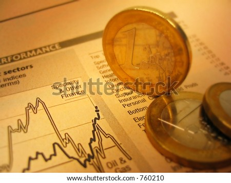 Euro coins and financial chart - stock photo