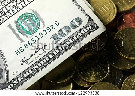 Euro coins and us dollar banknote background. Finance concept co