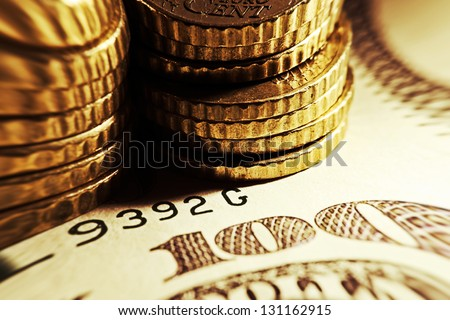 Euro coins and us dollar banknote background. Pincushion lens us