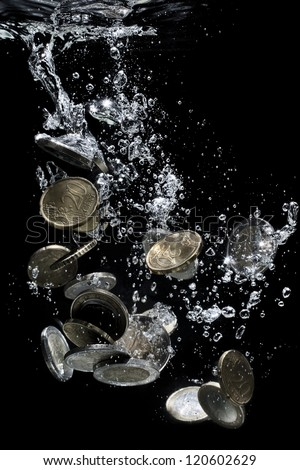 Euro coins falling down to water, metaphor of bankruptcy, crisis