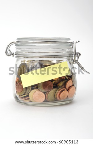 Euro coins in a glass jar with blank label on white background