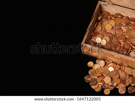 Euro coins in chest on black backgrtound. View from top. Сток-фото ©