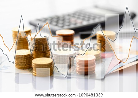 Euro coins in pile on Euro banknotes with charts, background. Germany