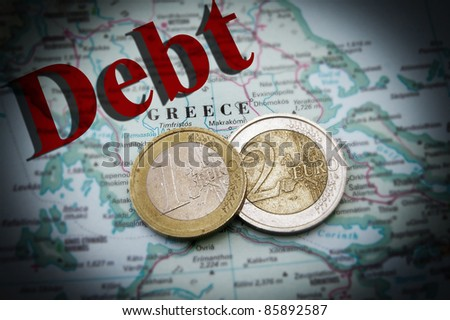 Euro coins on a map of Greece with Debt text (Greek financial crisis)