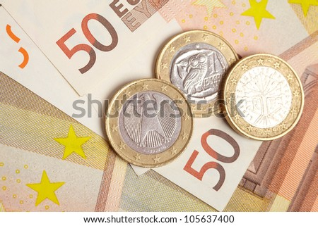Euro coins on banknote money background - stock photo