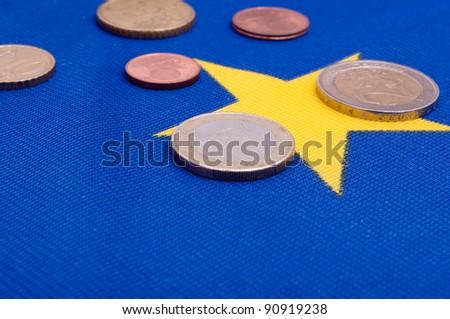 Euro Coins on Blue Flag of European Union