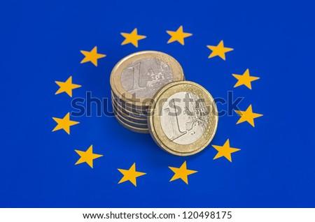 euro coins on european flag