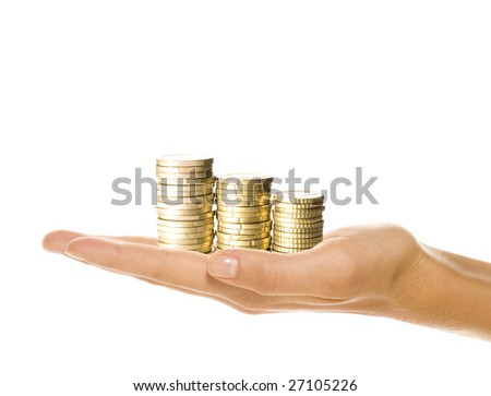 euro coins piled up in woman's hand isolated on white
