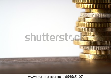 Euro coins stacked on each other in different positions Zdjęcia stock ©