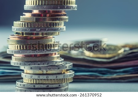 Euro coins stacked on each other in different positions.