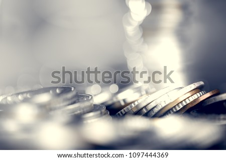 Euro coins with shallow depth of field. European currency close up. Banking, economics, saving money. #1097444369