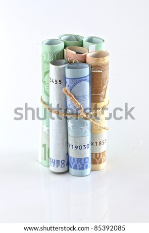 Euro crisis.Euro bills rolled up and tied with string and isolated. Money is tied up or tight concept