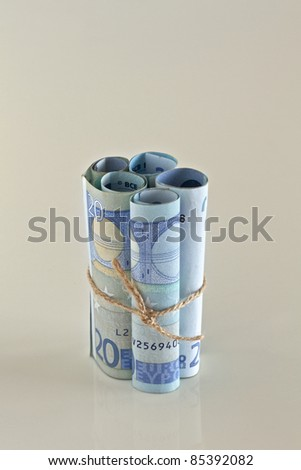 Euro crisis.Euro bills tied with string.  Money is tied up or tight concept.
