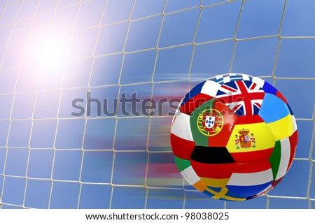 Euro cup soccer ball with flags over a goal's net